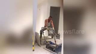 Construction worker caught dancing on the job - Video