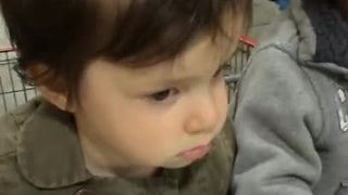 Adorable kid too tired to shop with dad