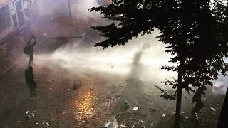 Protesters Sprayed by Water Cannons During G20 Demonstrations - Video