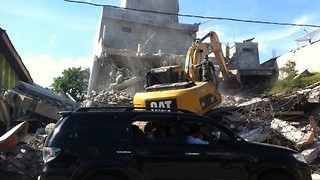 Bulldozer Digs Through Rubble After Aceh Quake - Video