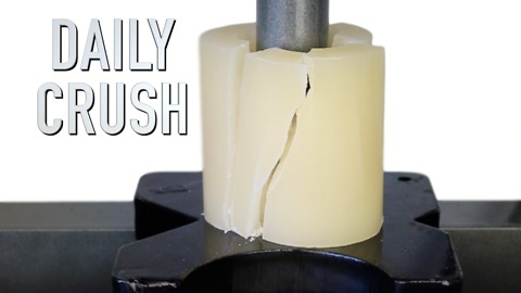 Crushing a candle with hydraulic press