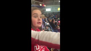 Canadian girl witnesses hockey fight for the first time