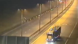 Man jailed after driving truck in reverse towards incoming traffic - Video