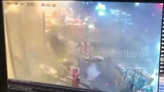 Gas cylinder explosion injures 11 in Chinese market - Video