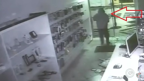 Robber Face Plants into Glass Door