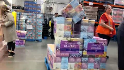 Coronavirus continues to cause extreme lineups, store employees guard toilet tissue supplies