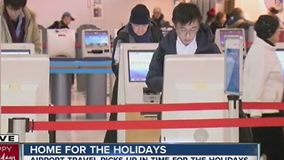 Airport travel picks up in time for the holidays - Video