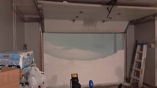 Garage door opening dramatically reveals blizzard outside