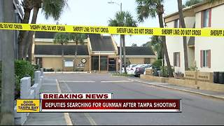 Detectives search for girlfriend's son after man shot dead outside Tampa apartment - Video