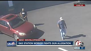 Gas Station worker fights gun allegation - Video