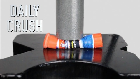 Crushing a glue stick with hydraulic press