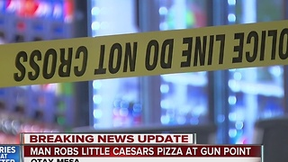 Man robs Little Ceasars at gunpoint - Video