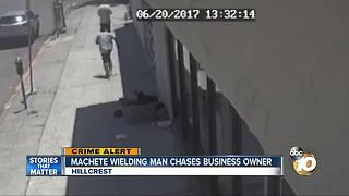 Machete wielding man chases business owner - Video
