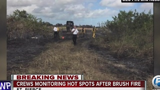 Crews monitoring hot spots after brush fire - Video