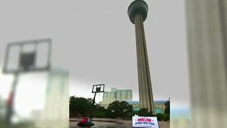 Harlem Globetrotters' star shoots basket from top of tower - Video