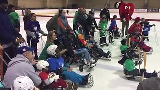 Kids with special needs take to the ice - Video