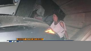Woman survives after stolen car hits her home - Video
