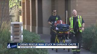 Man gets stuck in garbage chute in Whitefish Bay - Video