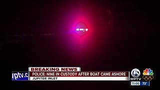 9 in custody after boat comes ashore in Jupiter - Video