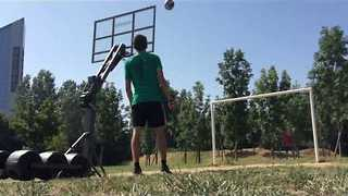 Guy Manages to Shoot a Hoop With Insane Crossbar Shot - Video
