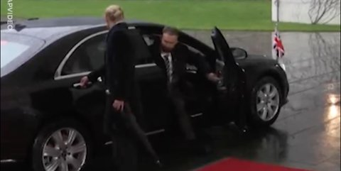 Theresa May STRUGGLING with her car door is everything you need to see today