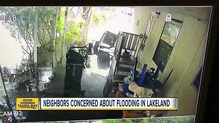 Unseasonable rains have Lakeland residents on edge as flood waters rise from drainage canal - Video