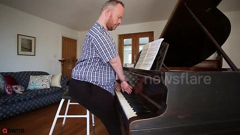 Man born without elbows defies odds by learning to play piano