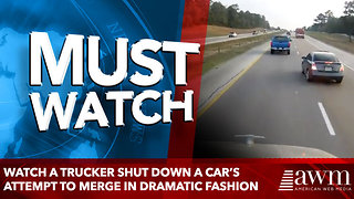 Watch a trucker shut down a car's attempt to merge in dramatic fashion - Video