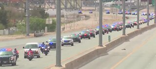 Police escort fallen trooper's body home