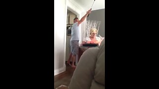 Canadian woman screams and jumps out chair after spider prank