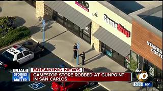 GameStop store robbed at gunpoint - Video
