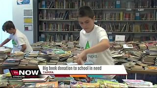 Kids helping kids with big book donation - Video