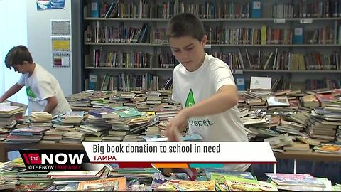 Kids helping kids with big book donation