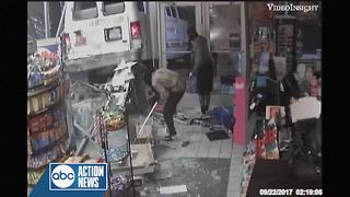 Surveillance video shows suspects crash stolen van into Sunoco gas station - Video