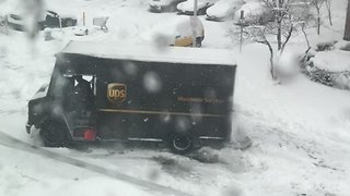 UPS Truck Struggles in New York Snow - Video
