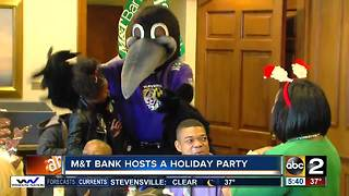 M&T Bank hosts a holiday party - Video