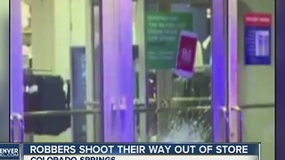 Robbers shoot their way out of store - Video