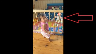 Baby dances along to toy robot  - Video