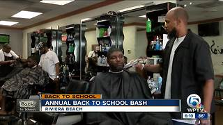 Annual back to school event held at Riviera Beach barbershop
