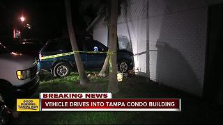Vehicle drives into Tampa condo building - Video
