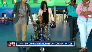 Two-year-old patient receives customized tricycle - Video