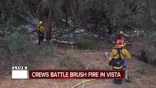 Crews battle brush fire in Vista - Video