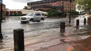 Cars drive through flooded Annapolis streets as river overflows