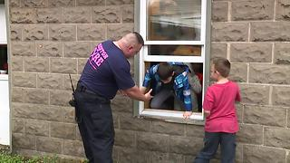 Mentor kids escape smoky room for a special fire drill - Video