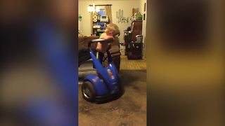 A Young Boy Gets Dizzy After Spinning On A Segway - Video