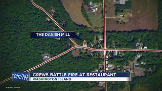Crews battle restaurant fire on Washington Island - Video