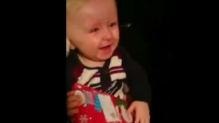 Gift-Opening Sent Baby Into Contagious Fit Of Giggles - Video
