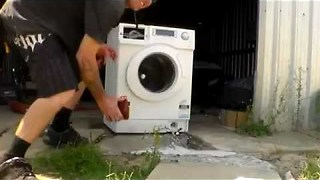 Washing machine gets totalled by brick inside! || Viral Video UK - Video
