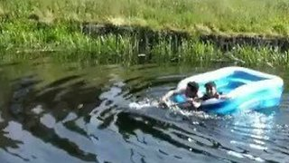Two Lads Row Inflatable Pool Down Scotland's Clydebank Canal