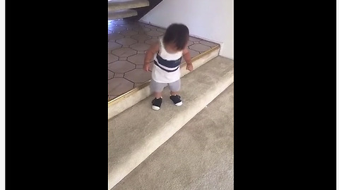 Fearless baby learns to conquer the stairs